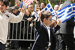 Greek Parade in New York City. Kids waving flags in the Greek Parade in New York City.