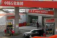 A Sinopec gas station in Beijing China. Sinopec, China's biggest listed company, wants to buy oilfields from Algeria to Indonesia next year. A stronger yuan could shave hundreds of millions of dollars off those purchases..