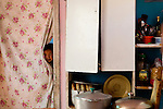 Kyrgyz girl hiding behind curtain, Besh Moinok, Tien Shan Mountains, eastern Kyrgyzstan