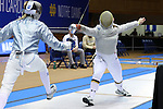 DURHAM, NC - FEBRUARY 25: Notre Dame's Claudia Kulmacz (right) attacks Duke's Lindsay Sapienza (left) during their Women's Saber semifinal match. The Atlantic Coast Conference Fencing Championships were held on February, 25, 2017, at Cameron Indoor Stadium in Durham, NC.