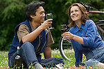 Couple enjoying wine in meadow