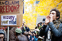 "After marching earlier in the morning with the aim to shut down Wall Street and the Stock Exchange, hundreds of protesters regather in Zuccotti Park to determine their next move on November 17, 2011 in New York City.  The action was the first in a day of protests celebrating the two month anniversary of the ""Occupy Wall Street"" movement.  While many workers were inconvenienced by the human (and police) barricades, the Stock Exchange opened on schedule."