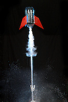 A two liter soda bottle is filled with 400ml of water and pressurized to 8 atmospheric pressures..When the bottom clamp is released, the soda bottle becomes a rocket that can reach a height in excess of 150 meters.  This activity is used with students to study rockets.  This rocket is photographed with a high speed flash.