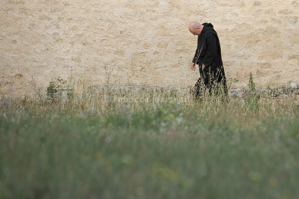 Pere Michel walks to Vespers, Ganagobie Monastery, Alpes de Haute Provence, France. 16 July 2009.