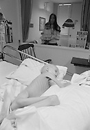"March 1979, Memphis, Tennessee, USA --- Five-year-old Stacey Haddock from Little Rock, Arkansas fights for her life, looked on by her mother. Stacey is suffering from ""neuroblastoma"" and lost her battle when she died a few days later. Founded by Lebanese actor Danny Thomas, the hospital was the first to cure leukemia in children (Acute Lymphocytic Leukemia) in 1971. --- Image by © JP Laffont"