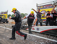 Aug 19, 2018; Brainerd, MN, USA; NHRA top fuel driver Billy Torrence is doused with a cooler of ice water as he celebrates with crew after winning the Lucas Oil Nationals at Brainerd International Raceway. Mandatory Credit: Mark J. Rebilas-USA TODAY Sports