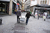Two men collecting scrap metal in Granada, Andalucia.  The province has the highest unemployment rate in Spain.