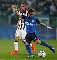 Calcio, quarti di finale di andata di Champions League: Juventus vs Monaco. Torino, Juventus stadium, 14 aprile 2015.<br /> Monaco's Joao Moutinho, right, kicks the ball past Juventus' Claudio Marchisio during the Champions League quarterfinals first leg football match between Juventus and Monaco at Juventus stadium, 14 April 2015.<br /> UPDATE IMAGES PRESS/Isabella Bonotto