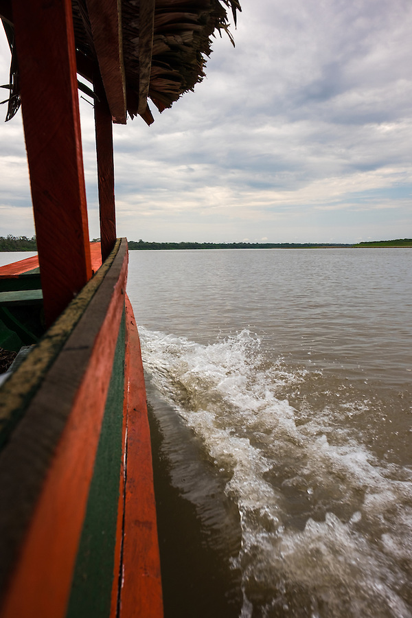 LORETO, PERU - CIRCA OCTOBER 2015:  Local motorboat in the Ucayali river in the Peruvian Amazon.