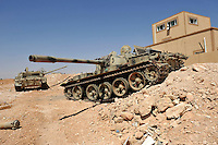 Abandoned loyalist army tanks lie in the desert in western Libya. After a six month revolution, rebel forces finally managed to break into Tripoli and have taken control of Bab al-Aziziyah, Col Gaddafi's compound and residence. Few remain that are loyal to Gaddafi in the city; it is seeming that the 42 year regime has come to an end. Gaddafi is currently on the run.