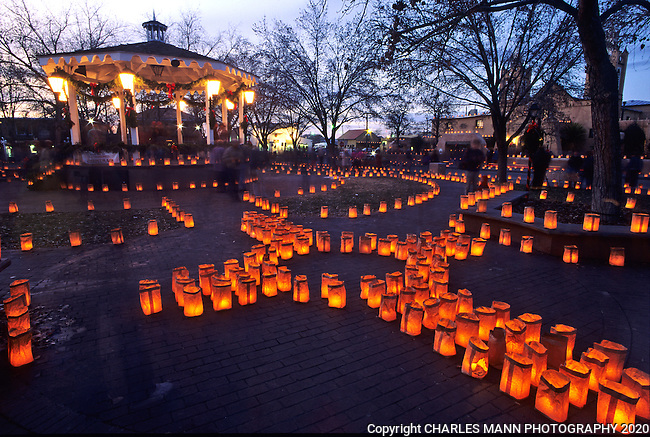 On Christmas Eve, the Old Town Plaza in Albuquerque is made festive by the  arrangement of hundreds of faralitos, each a candle in a paper bag.