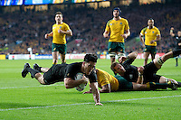 Nehe Milner-Skudder of New Zealand dives for the try-line in the first half. Rugby World Cup Final between New Zealand and Australia on October 31, 2015 at Twickenham Stadium in London, England. Photo by: Patrick Khachfe / Onside Images