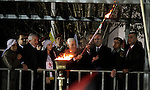 Palestinian President Mahmoud Abbas lights a torch during a rally marking the 50th anniversary of the founding of the Fatah movement, in the West Bank city of Ramallah December 31, 2014. Abbas signed on to 20 international agreements on Wednesday, including the Rome Statute of the International Criminal Court, a day after a bid for independence by 2017 failed at the United Nations Security Council. Photo by Shadi Hatem
