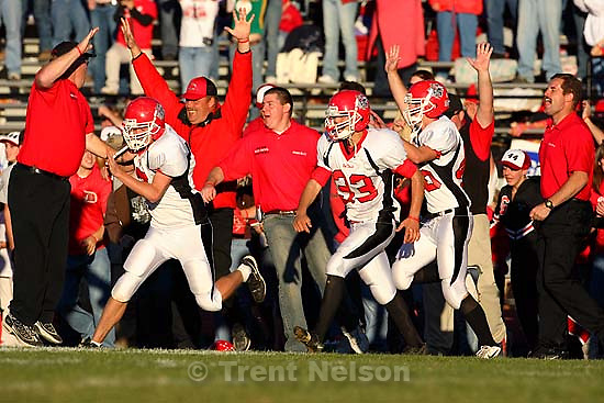 Grand players and coaches swarm onto the field as time runs out and they win 25-22. Grand vs. San Juan, 2A State Football Championship game at Southern Utah University's Eccles Coliseum in Cedar City.<br />