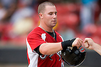 Stephen Chapman #6 of the Carolina Mudcats fist bumps a teammate after scoring a run against the Birmingham Barons at Five County Stadium August 16, 2009 in Zebulon, North Carolina. (Photo by Brian Westerholt / Four Seam Images)