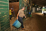New York Post Columnist John Crudele cleans a stall while working in the barn of Trainer Chuck Spina at Monmouth Park in Oceanport, New Jersey on Saturday July 9, 2016. Photo By Bill Denver/EQUI-PHOTO