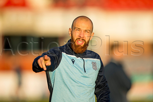 30th November 2019; Dens Park, Dundee, Scotland; Scottish Championship Football, Dundee Football Club versus Queen of the South; Jordon Forster of Dundee during the warm up before the match  - Editorial Use