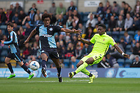 Rakish Bingham of Hartlepool United hits a ball past Sido Jombati of Wycombe Wanderers during the Sky Bet League 2 match between Wycombe Wanderers and Hartlepool United at Adams Park, High Wycombe, England on 5 September 2015. Photo by Andy Rowland.