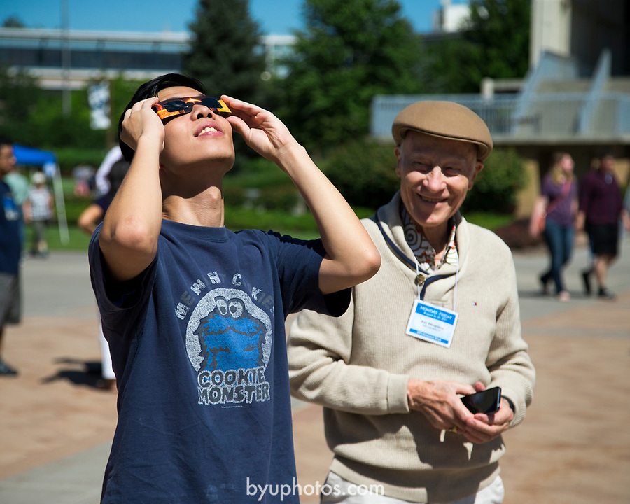 1708-56 442<br /> 1708-56 Solar Eclipse on Campus<br /> <br /> Solar Eclipse on Campus<br /> <br /> <br /> August 21, 2017<br /> <br /> Photography by Madeline Mortensen/BYU<br /> <br /> &copy; BYU PHOTO 2011<br /> All Rights Reserved<br /> photo@byu.edu  (801)422-7322