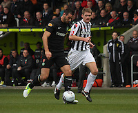 Joe Ledley tracked by David van Zanten in the St Mirren v Celtic Clydesdale Bank Scottish Premier League match played at St Mirren Park, Paisley on 20.10.12.