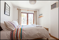 BNPS.co.uk (01202 558833)<br /> Pic: Jackson-Stops/BNPS<br /> <br /> ****Please use full byline****<br /> <br /> Bedroom.<br /> <br /> A stunning cliff-top house has grown into a 1.25 million pounds property after it was built on a disused allotment.<br /> <br /> Jamie and Zoe McLintock forked out &pound;80,000 for the overgrown plot of land eleven years ago because it was atop a cliff along Devon's craggy coastline.<br /> <br /> The enterprising couple spent a further &pound;600,000 and three years of their time building the beautiful five-bedroom pad.<br /> <br /> But they are now set to double their money after the incredible property went on the market for a whopping &pound;1.25 million with estate agents Jackson-Stops.<br /> <br /> The white-washed three-storey house is perched on top of 100ft cliffs overlooking Tunnels Beaches in Ilfracombe, a stretch of private Victorian beach owned by the couple since 2001.