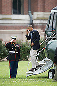 United States President Barack Obama salutes the Marine Guard as he exits Marine One at Fort Lesley J. McNair in Washington, D.C., as he returns from a week-end Camp David, Sunday, August  3, 2014. <br /> Credit: Drew Angerer / Pool via CNP