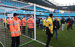Stewrads protect the goal mouth area as fans invade the pitch during the premier league match at the Etihad Stadium, Manchester. Picture date 22nd April 2018. Picture credit should read: Simon Bellis/Sportimage