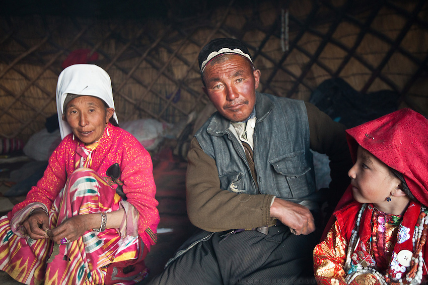 A Kyrgyz family. Abdul Rahman, his wife and one of his daughter. Summer camp of Muqur, Er Ali Boi's place...Trekking through the high altitude plateau of the Little Pamir mountains (average 4200 meters) , where the Afghan Kyrgyz community live all year, on the borders of China, Tajikistan and Pakistan.