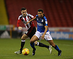 Danny Lafferty of Sheffield Utd and Jermaine Hylton of Swindon Town during the English League One match at Bramall Lane Stadium, Sheffield. Picture date: December 10th, 2016. Pic Simon Bellis/Sportimage
