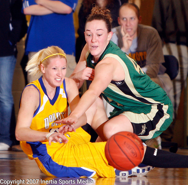 MADISON, S.D. - JANUARY 18, 2008 -- Lauren Tewes #34 of Dakota State (left) and Lacey Haughian #44 of Black Hills State battle for a loose ball during their game Friday evening at the DSU Memorial Field House.