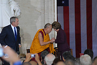 Washington DC., USA, October 17, 2007 <br /> His Holiness The  14th Dalia Lama Lhamo Dondrub of Tibet greets Speaker of the House Nancy Pelosi (D) Ca. with the traditional Buddhist head bump of greeting as President George Bush look on. Credit: Mark Reinstein/MediaPunch