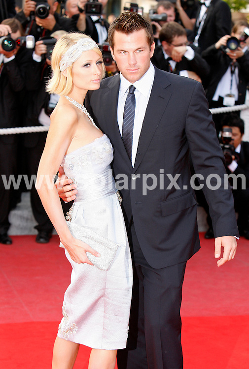 **ALL ROUND PICTURES FROM SOLARPIX.COM**.**SYNDICATION RIGHTS FOR UK AND SPAIN ONLY**.Arrivals at the premiere of Inglourious Basterds at the 62nd Cannes Film Festival in Cannes, France. .This pic:  Paris Hilton & Doug Reinhardt.JOB REF:      9067    CPR/Heinz        DATE:  21.05.09.**MUST CREDIT SOLARPIX.COM OR DOUBLE FEE WILL BE CHARGED**.**ONLINE USAGE FEE GBP 50.00 PER PICTURE - NOTIFICATION OF USAGE TO PHOTO @ SOLARPIX.COM**.**CALL SOLARPIX : +34 952 811 768 or LOW RATE FROM UK 0844 617 7637**