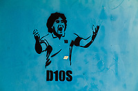 A spray paint stencil artwork, depicting legendary Argentine football player Diego Maradona, is seen painted in the street of San Jose, Costa Rica, 10 September 2004.