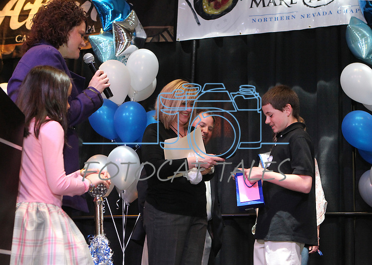 Nevada First Lady Kathleen Sandoval and her daughter Marisa, left, acknowledge Garrett Gouldsmith during the Make-A-Wish Foundation Waffles & Wishes event at the Atlantis Casino Resort, in Reno, Nev., on Tuesday, March 27, 2012. His sister Gabby, 8, who suffers from an auto-immune deficiency disorder, received a bedroom makeover from the organization..Photo by Cathleen Allison