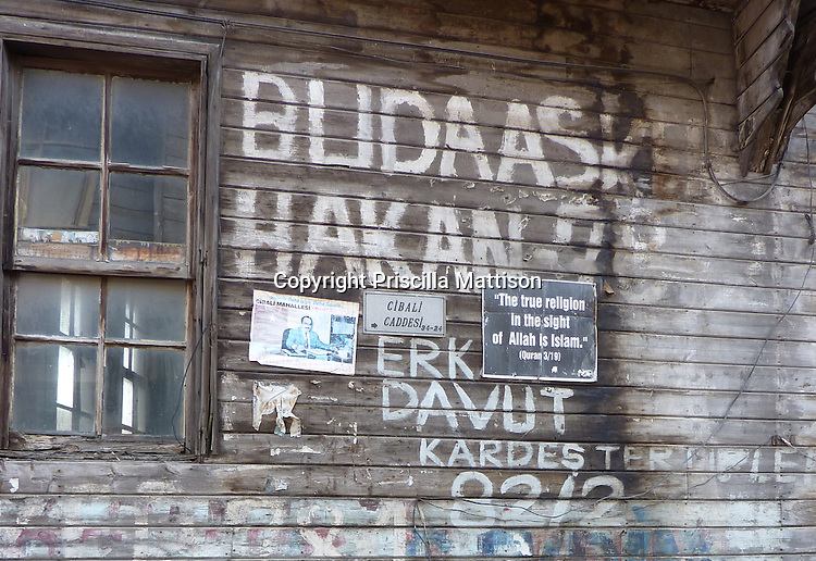 "Istanbul, Turkey - September 23, 2009:  A poster on the side of a building reads, ""The true religion in the sight of Allah is Islam""."
