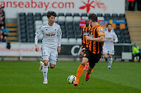 SWANSEA, WALES - APRIL 04: Ki Sung-Yueng of Swansea City  in action  during the Premier League match between Swansea City and Hull City at Liberty Stadium on April 04, 2015 in Swansea, Wales.  (photo by Athena Pictures)