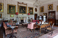 Gilt framed portraits of past Scudamores hang in the drawing room
