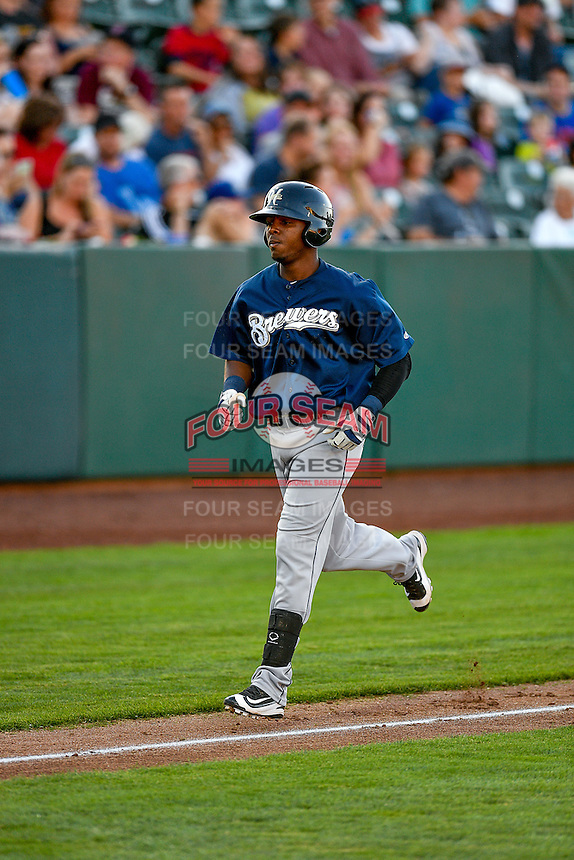 Yerald Martinez (7) of the Helena Brewers trots to home after hitting a home run during the game against the Ogden Raptors in Pioneer League action at Lindquist Field on July 16, 2016 in Ogden, Utah. Helena defeated Ogden 13-5. (Stephen Smith/Four Seam Images)