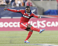 Chicago Fire defender Jalil Anibaba (6) passes the ball. In a Major League Soccer (MLS) match, the New England Revolution (blue) defeated Chicago Fire (red), 1-0, at Gillette Stadium on October 20, 2012.