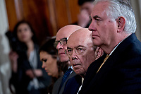 Wilbur Ross, U.S. commerce secretary, center, and Rex Tillerson, U.S. secretary of State, right, listen during a news conference with U.S. President Donald Trump and Stefan Lofven, Sweden's prime minister, not pictured, in the East Room of the White House in Washington, D.C., U.S., on Tuesday, March 6, 2018. Trump and Lofven are looking to focus on trade and investment between the two countries and ways to achieve shared defense goals. <br /> CAP/MPI/RS<br /> &copy;RS/MPI/Capital Pictures