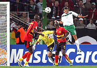 Jose Fonseca (17) of Mexico heads the ball towards Angola's goal. Mexico and Angola played to a 0-0 tie in their FIFA World Cup Group D match at FIFA World Cup Stadium, Hanover, Germany, June 16, 2006.