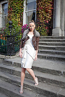 30/9/2010. Karen Millen Autumn Winter 2010 Christmas collection. Model Sarah wears silver metallic lurex dress EUR235, Tan leather and fur jacket EUR499 and nudge cadge sandal EUR160 at a sneak preview of the Karen Millen Autumn Winter 2010 Christmas collection in Dublin. Picture James Horan/Collins Photos
