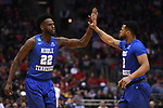 MILWAUKEE, WI - MARCH 18: Middle Tennessee Blue Raiders forward JaCorey Williams (22) and guard Antwain Johnson (2) high five during the first half of the 2017 NCAA Men's Basketball Tournament held at BMO Harris Bradley Center on March 18, 2017 in Milwaukee, Wisconsin. (Photo by Jamie Schwaberow/NCAA Photos via Getty Images)