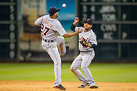 Detroit Tigers shortstop Jhonny Peralta (27) bobbles a ground ball as second baseman Omar Infante (4) looks on  during the MLB baseball game against the Houston Astros on May 3, 2013 at Minute Maid Park in Houston, Texas. Detroit defeated Houston 4-3. (Andrew Woolley/Four Seam Images).