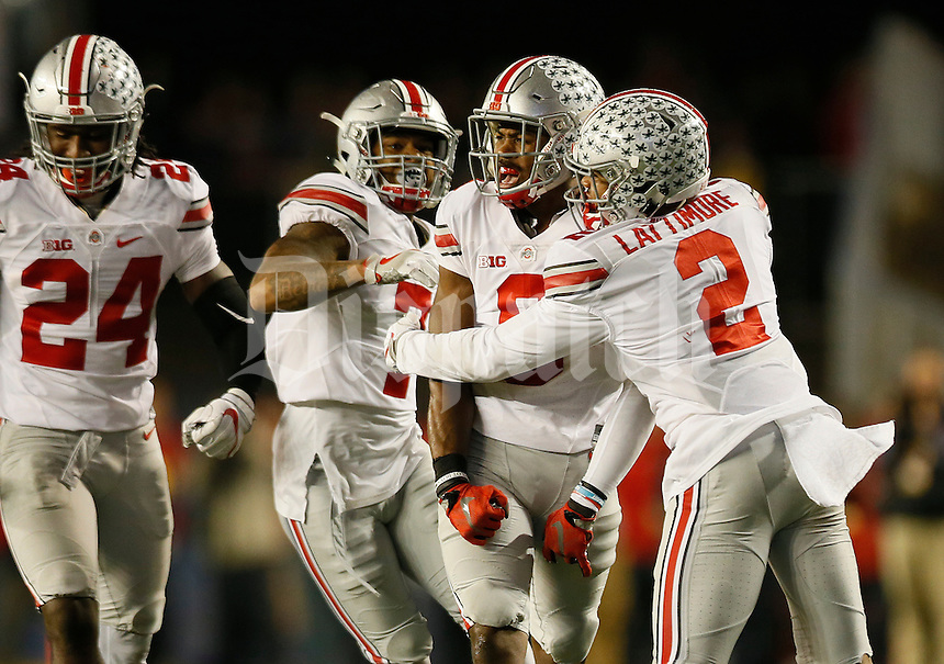 Ohio State Buckeyes cornerback Gareon Conley (8) celebrates an interception with cornerback Marshon Lattimore (2), cornerback Damon Webb (7) and safety Malik Hooker (24) during the third quarter of the NCAA football game at Camp Randall Stadium in Madison, Wisconsin on Oct. 15, 2016. Ohio State won 30-23. (Adam Cairns / The Columbus Dispatch)