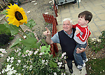 Peter James with his giant sunflower and his grandson..Photo NEWSFILE/Jenny Matthews.(Photo credit should read Jenny Matthews/NEWSFILE)....This Picture has been sent you under the condtions enclosed by:.Newsfile Ltd..The Studio,.Millmount Abbey,.Drogheda,.Co Meath..Ireland..Tel: +353(0)41-9871240.Fax: +353(0)41-9871260.GSM: +353(0)86-2500958.email: pictures@newsfile.ie.www.newsfile.ie.FTP: 193.120.102.198.