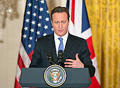 Prime Minister David Cameron of the United Kingdom makes remarks during a joint press conference with United States President Barack Obama (not pictured) in the East Room of the White House in Washington, D.C. on Friday, January 16, 2015. During the course of the press conference the leaders touched on issues such as cybersecurity, terrorism, ISIL and the economy.<br /> Credit: Ron Sachs / Pool via CNP