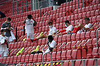 24th May 2020, Opel Arena, Mainz, Rhineland-Palatinate, Germany; Bundesliga football; Mainz 05 versus RB Leipzig;  Mainz substitute players wearing masks in the stands