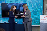 Ann Silverberg, Executive Vice President, BRIDGE Housing Corporation, presents a framed plaque to Susan Riggs, Acting Director, California Department of Housing and Community Development. The Rivermark Grand Opening, City of West Sacramento, Wednesday, June 10, 2015 in Sacramento, California.  Bridge Housing.  Photo/Victoria Sheridan