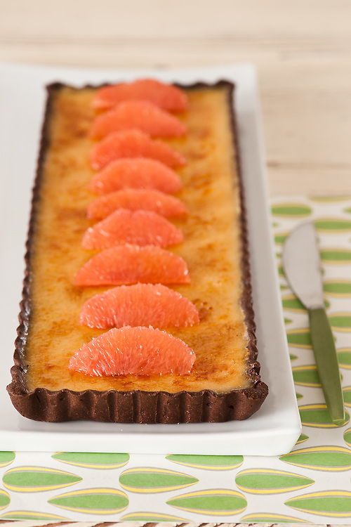 Bruleed ruby red grapefruit and  chocolate tart. Stylist Fiona Roberts for Sumptuous , Adelaide, South Australia.